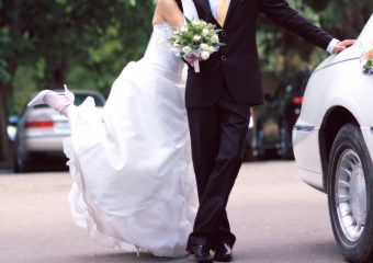 Bride and groom near limousine